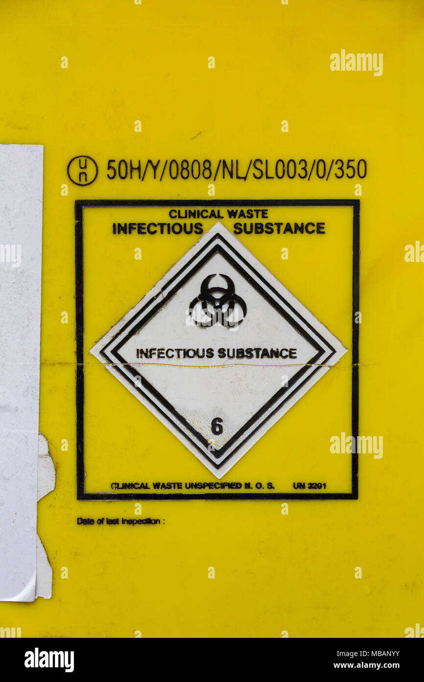 Clinical waste, infectious substance label on a bin used at a medical practise. - Stock Image