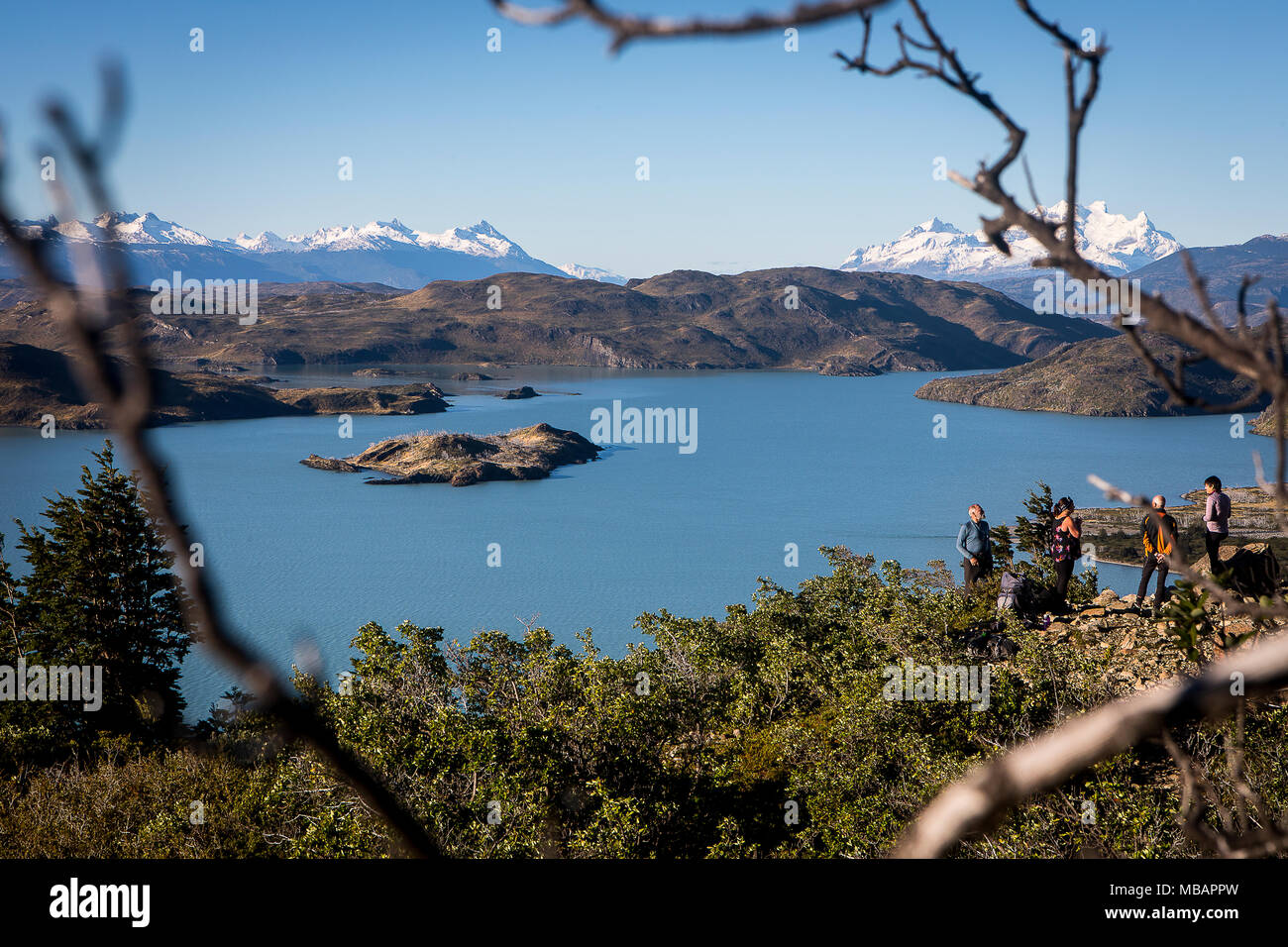Lago Nordenskjöld and Hikers resting between Cuernos refuge and Campamento Italiano, Torres del Paine national park, Patagonia, Chile - Stock Image