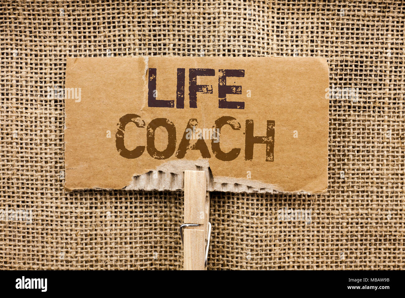 Writing note showing  Life Coach. Business photo showcasing Mentoring Guiding Career Guidance Encourage Trainer Mentor written Cardboard Piece Holding - Stock Image