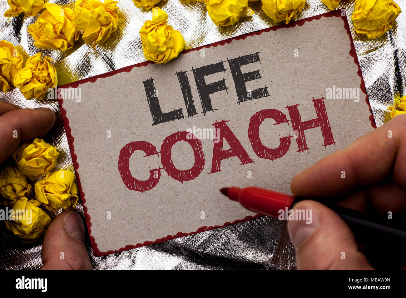 Conceptual hand writing showing Life Coach. Business photo showcasing Mentoring Guiding Career Guidance Encourage Trainer Mentor written by Man Holdin - Stock Image