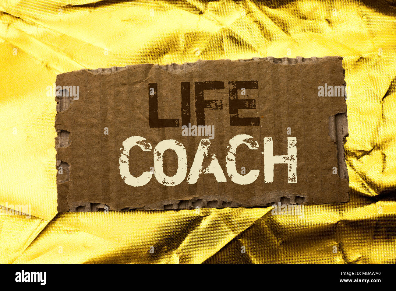 Word writing text Life Coach. Business concept for Mentoring Guiding Career Guidance Encourage Trainer Mentor written tear Cardboard Piece the Golden  - Stock Image