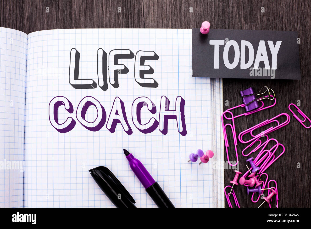 Handwriting text Life Coach. Concept meaning Mentoring Guiding Career Guidance Encourage Trainer Mentor written Notebook Book wooden background Today  - Stock Image