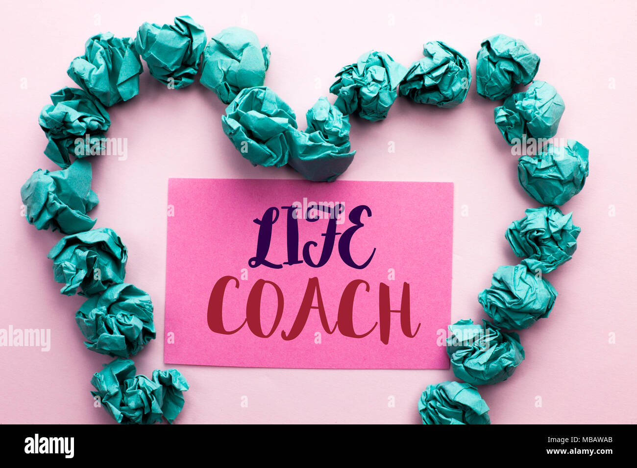 Word writing text Life Coach. Business concept for Mentoring Guiding Career Guidance Encourage Trainer Mentor written Pink Sticky Note Paper the plain - Stock Image