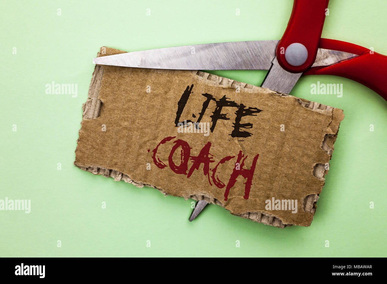 Text sign showing Life Coach. Conceptual photo Mentoring Guiding Career Guidance Encourage Trainer Mentor written Tear Cardboard the plain background  - Stock Image