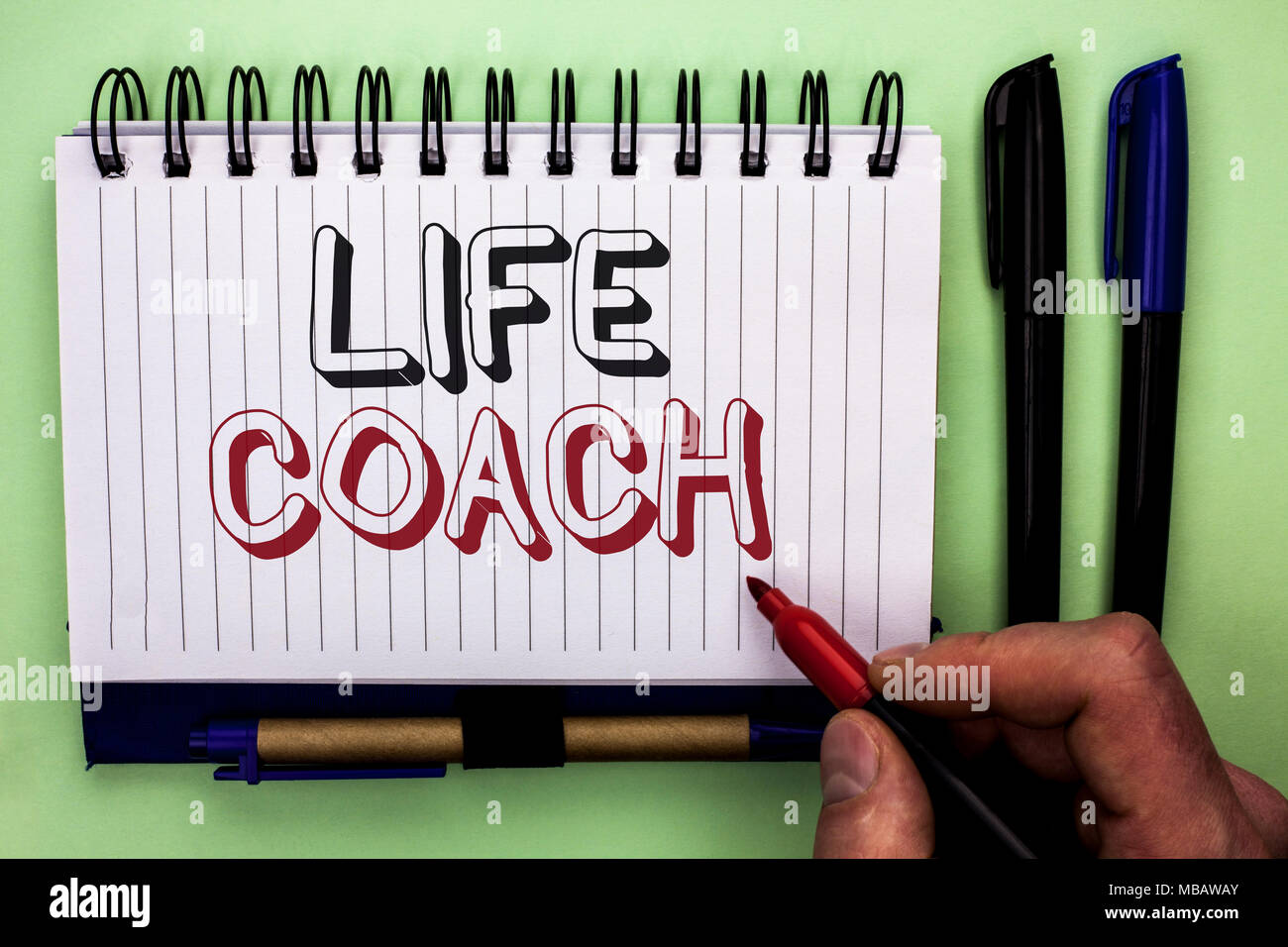 Writing note showing  Life Coach. Business photo showcasing Mentoring Guiding Career Guidance Encourage Trainer Mentor written by Man Holding Marker N - Stock Image
