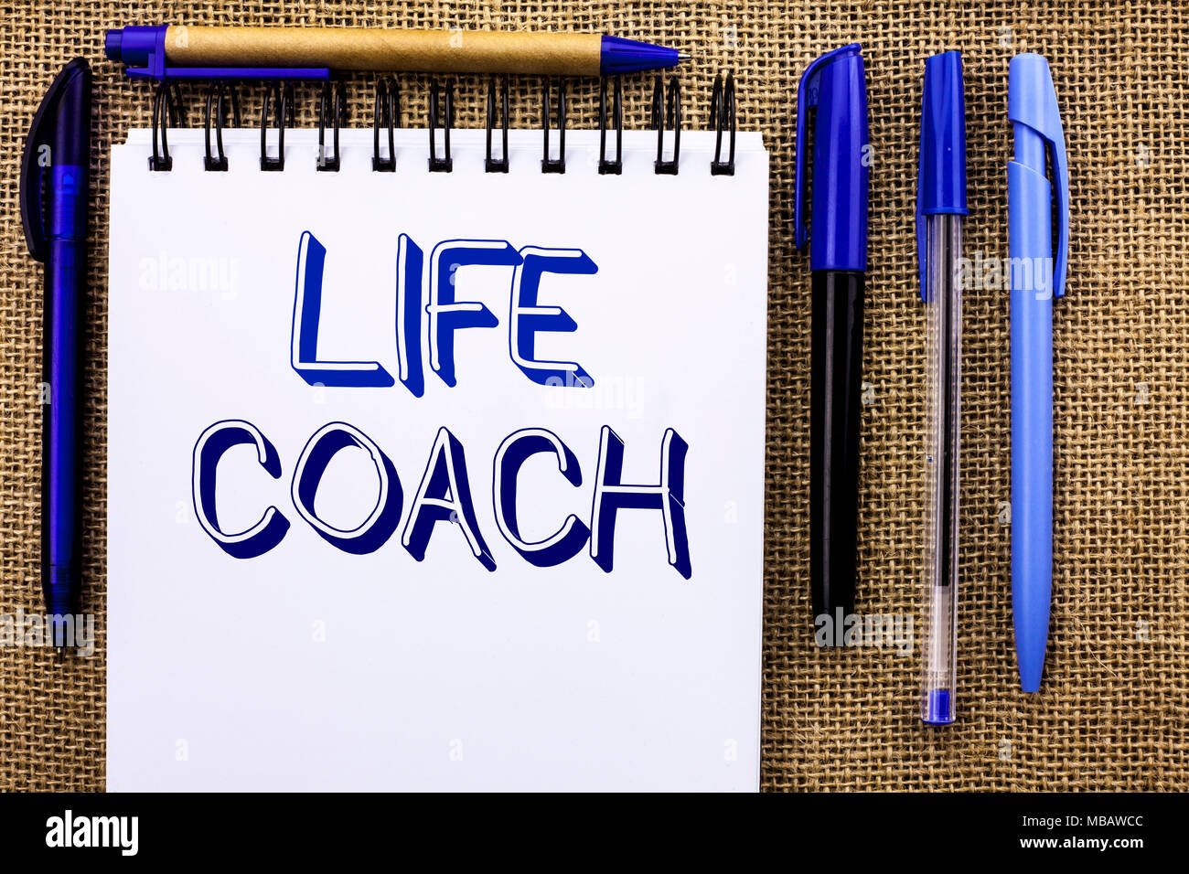 Writing note showing  Life Coach. Business photo showcasing Mentoring Guiding Career Guidance Encourage Trainer Mentor written Notebook Book the jute  - Stock Image