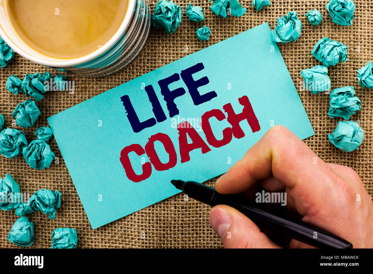 Writing note showing  Life Coach. Business photo showcasing Mentoring Guiding Career Guidance Encourage Trainer Mentor written by Man Holding Pen Stic - Stock Image