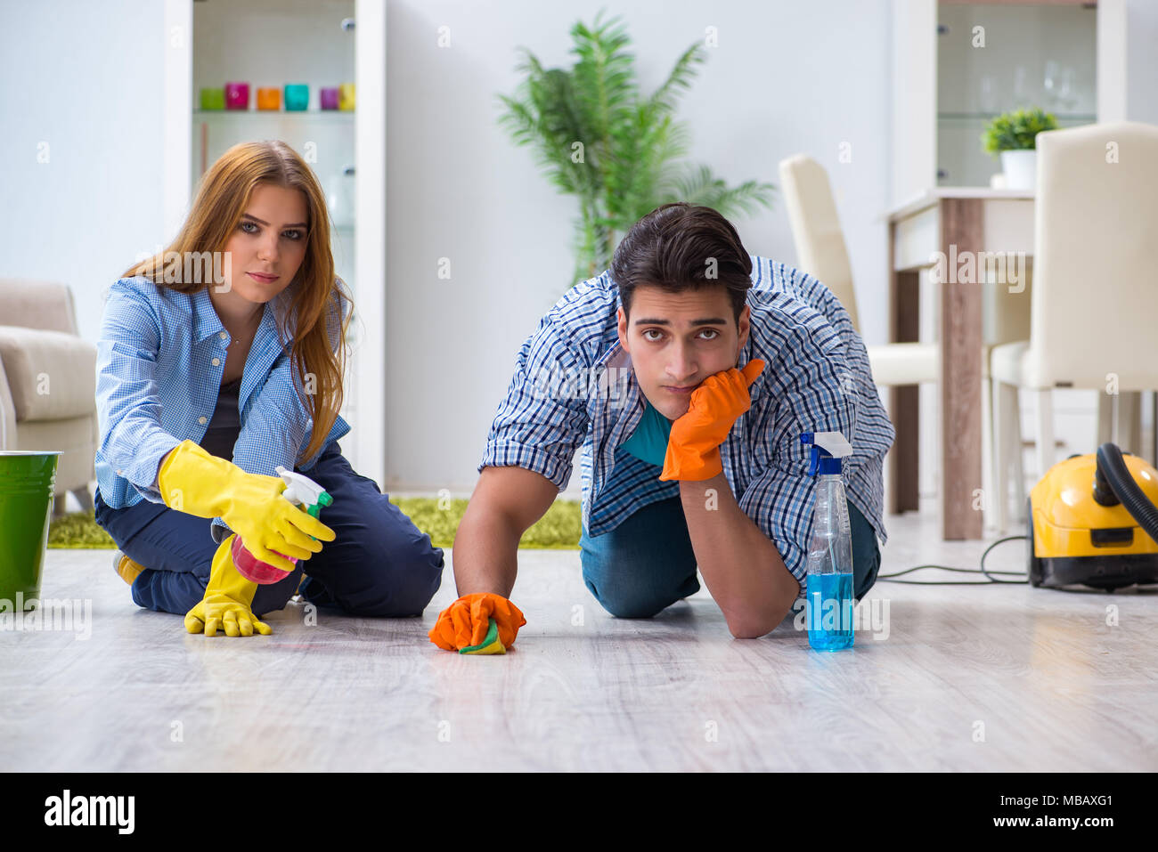 Couple Cleaning House Funny Stock Photos & Couple Cleaning