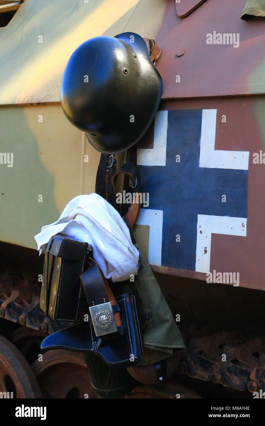 WW2 German soldier's equipment hanging from the side of an armoured tracked vehicle - Stock Image