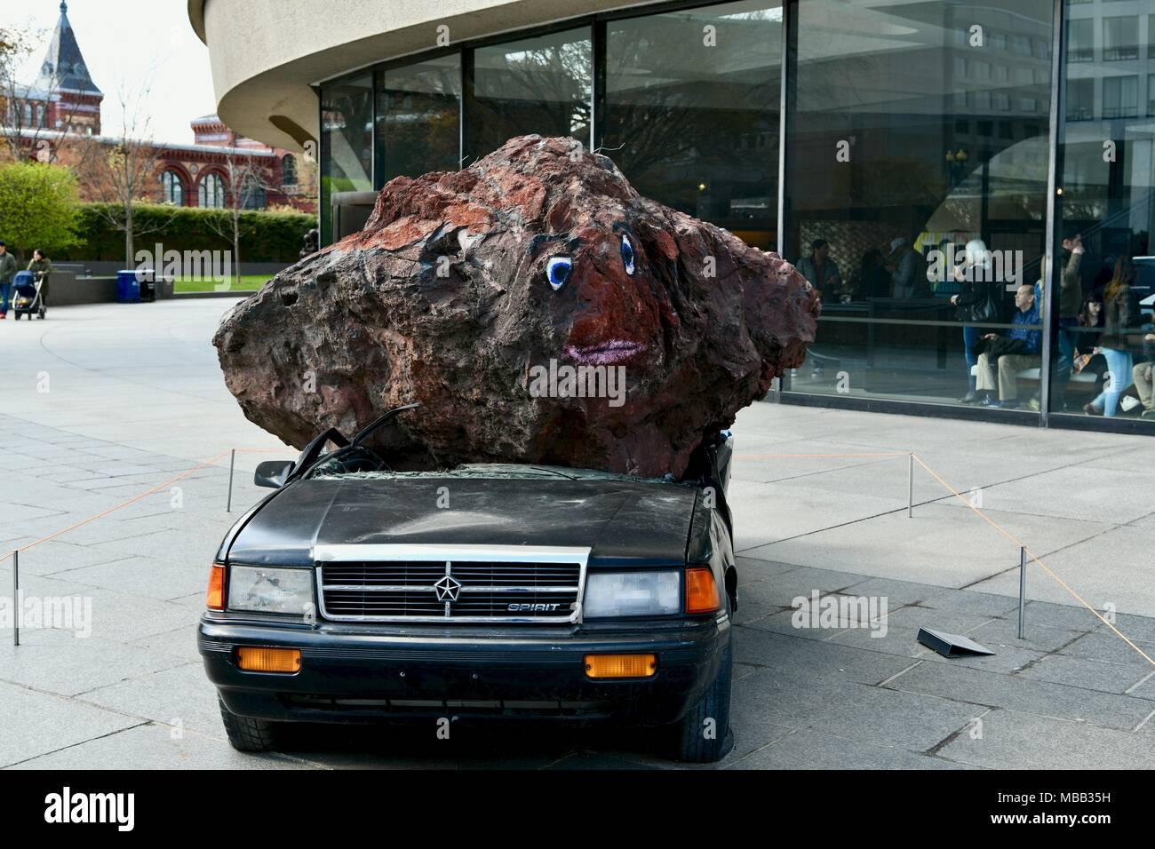 car smashed by a huge boulder on display outside the. Black Bedroom Furniture Sets. Home Design Ideas