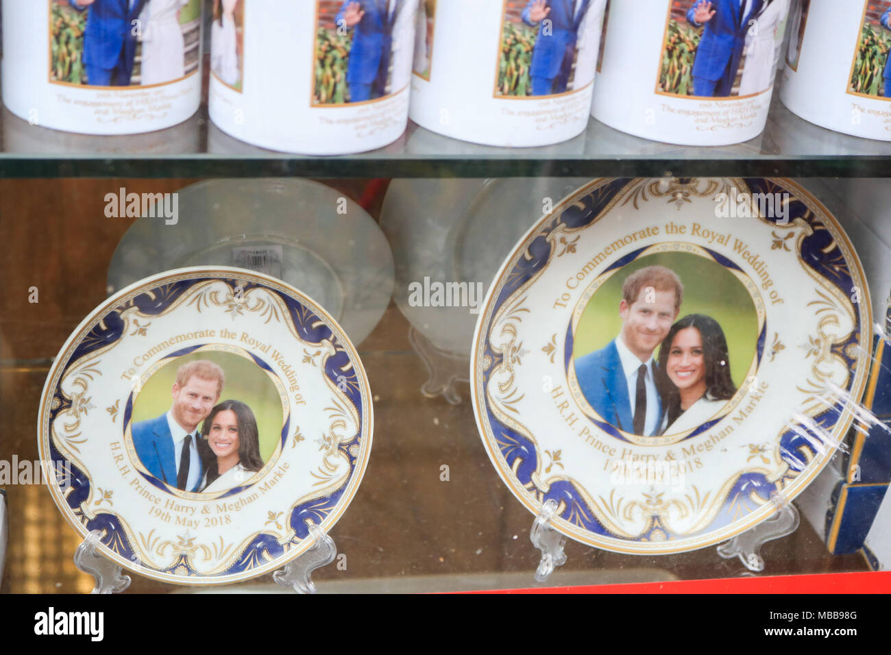 London UK. 10th April 2018. A Souvenir shop in central London Royal Wedding memorabilia with the portraits of HRH Prince Harry and his fiancee Meghan Markle featured on souvenr flags and mugs before the royal marriage at Windsor Castle   on 19th May 2018 Credit: amer ghazzal/Alamy Live News Stock Photo