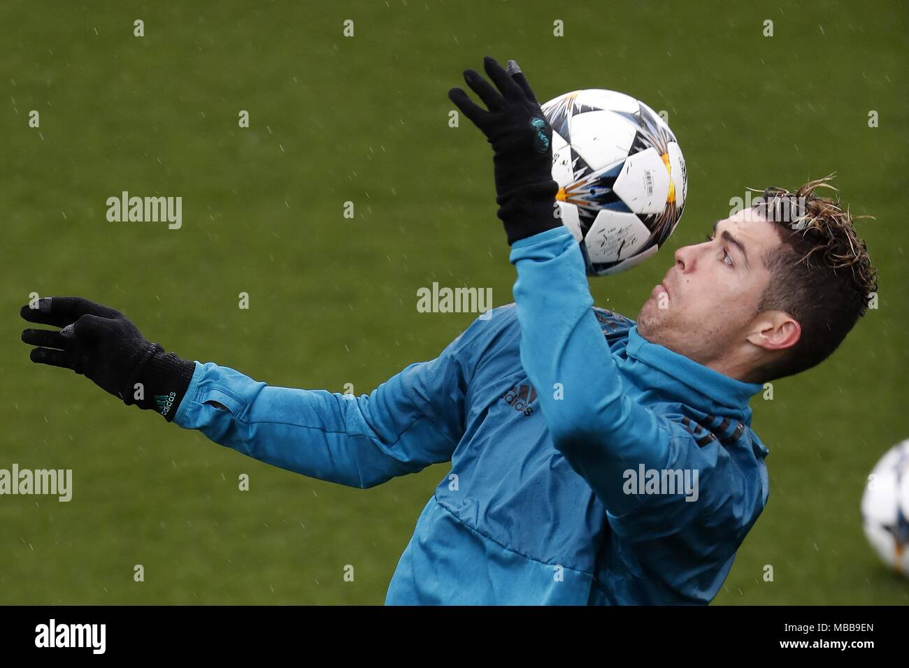 a1c9d51e59a Real Madrid s Portuguese forward Cristiano Ronaldo performs with the ball  during a training session at Valdebebas ...