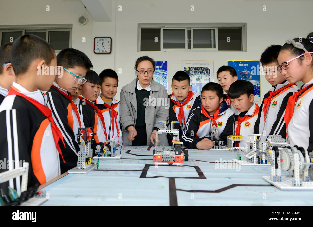 Tangshan, China's Hebei Province. 10th Apr, 2018. Students practise robots compitition during a class at a primary school in Laoting County, north China's Hebei Province, April 10, 2018. Robots are introduced into the extracurricular educational programs in the school. Credit: Mu Yu/Xinhua/Alamy Live News - Stock Image