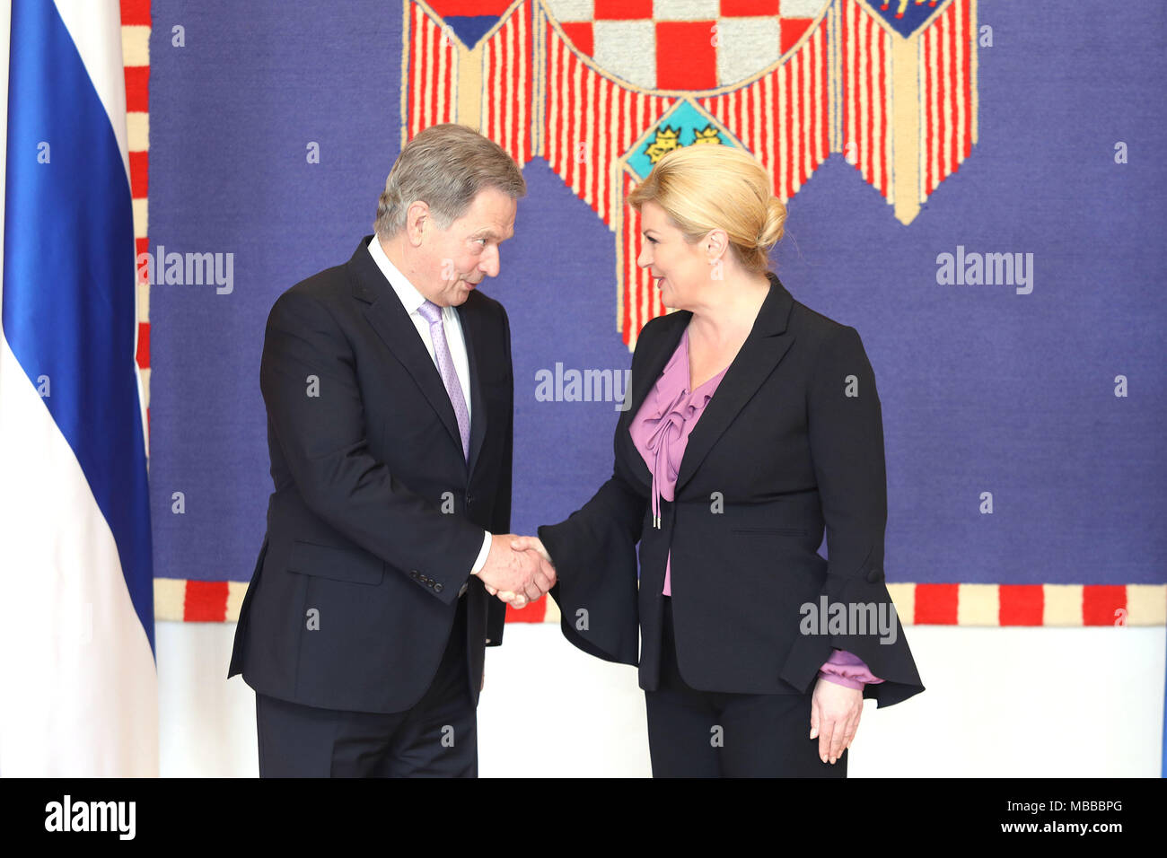 Zagreb, Croatia. 10th Apr, 2018. Visiting Finnish President Sauli Niinisto (L) shakes hands with Croatian President Kolinda Grabar-Kitarovic during a meeting at the Presidential Palace in Zagreb, capital of Croatia, on April 10, 2018. Sauli Niinisto is on a state visit to Croatia from Tuesday to Thursday. Credit: Patrik Macek/Xinhua/Alamy Live News - Stock Image