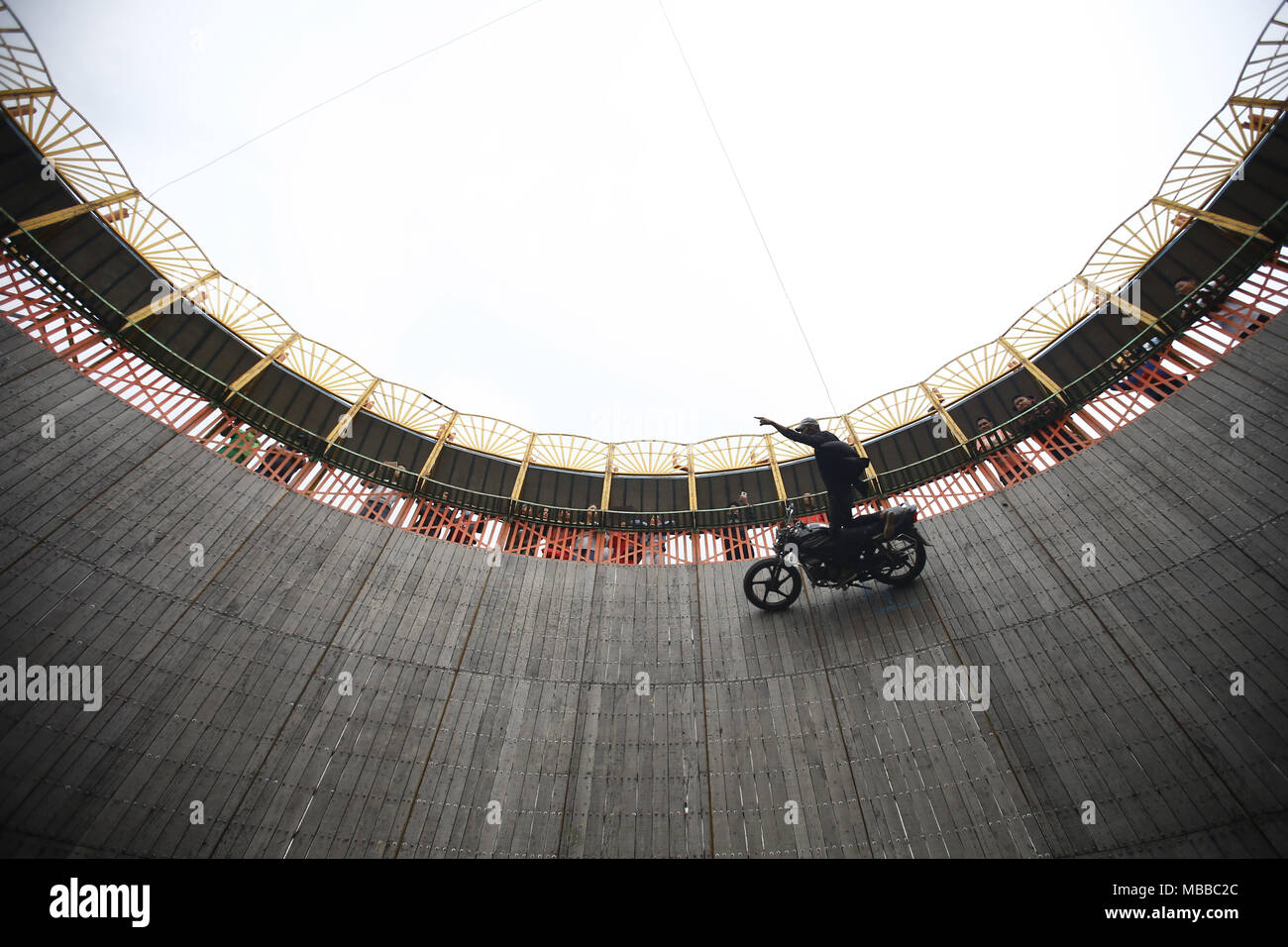 Bhaktapur, Nepal. 10th Apr, 2018. A stuntman gestures as he display his skills during the 'Well of Death' spectacle at a fair in Bhaktapur, Nepal on Tuesday, April 10, 2018. Credit: Skanda Gautam/ZUMA Wire/Alamy Live News - Stock Image