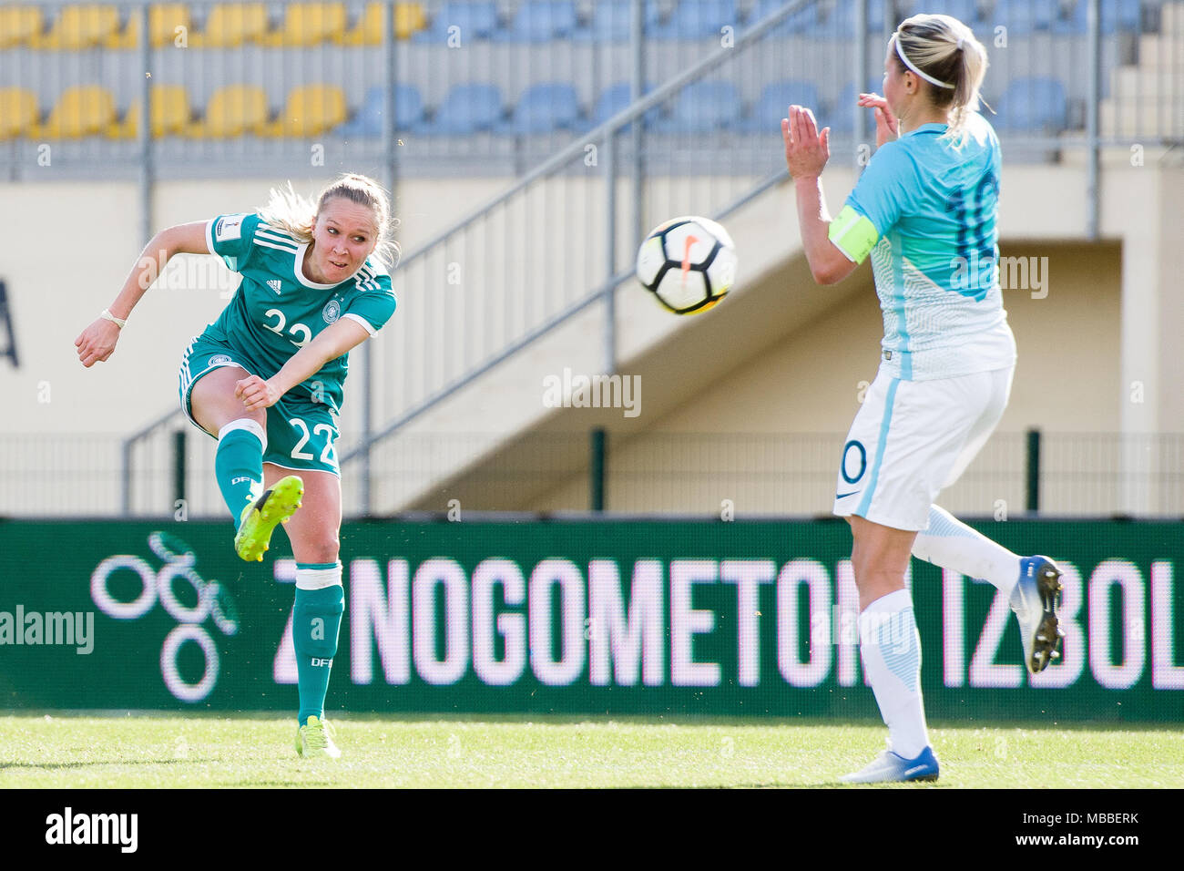 Domzale, Slovenia. 10th Apr, 2018. 10 April 2018, Slovenia, Domzale: Soccer, Women's World Cup qualification, Europe, group stages, Slovenia vs Germany. Germany's Turid Knaak (L) and Slovenia's Dominika Conc vie for the ball. Credit: Sasa Pahic Szabo/dpa/Alamy Live News - Stock Image