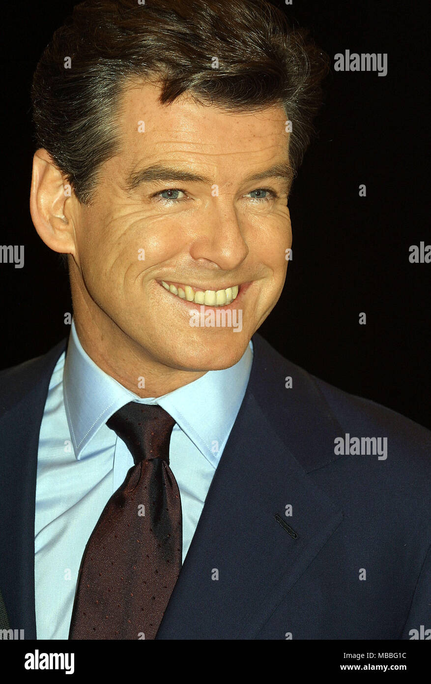 Pierce Brosnan at the Pinewood Studios for the James Bond film Die Another Day  with Rosamund Pike (left) and Halle Berry - Stock Image