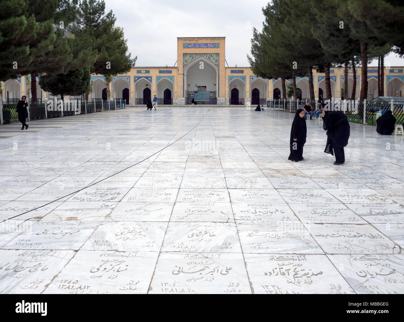 Muslim women in black at Khajeh Rabi Tomb cemetery, located along the Kashf River on the northern edge of Mashhad, Iran - Stock Image