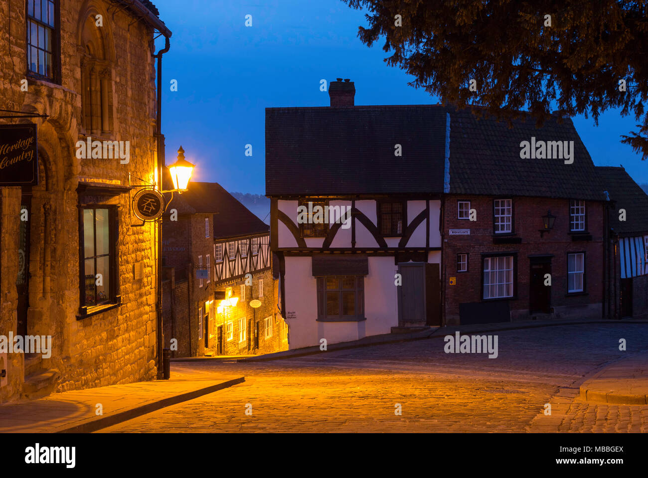 The Medieval buildings of Steep Hill, Lincoln. Lincolnshire, UK during the pre-dawn Blue Hour. - Stock Image