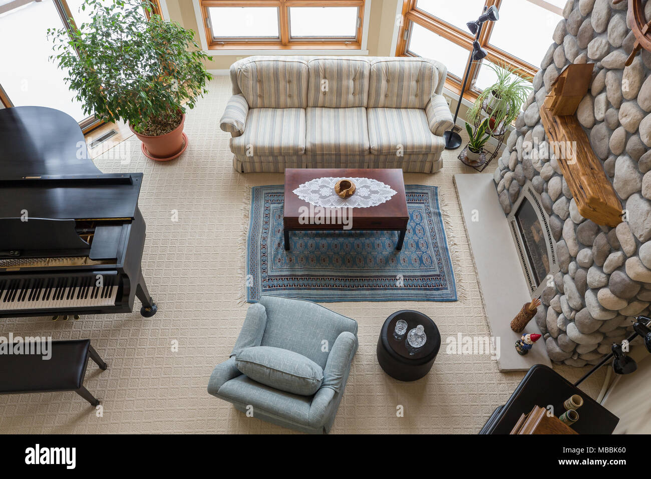 Upscale living room seen from above including piano floor to
