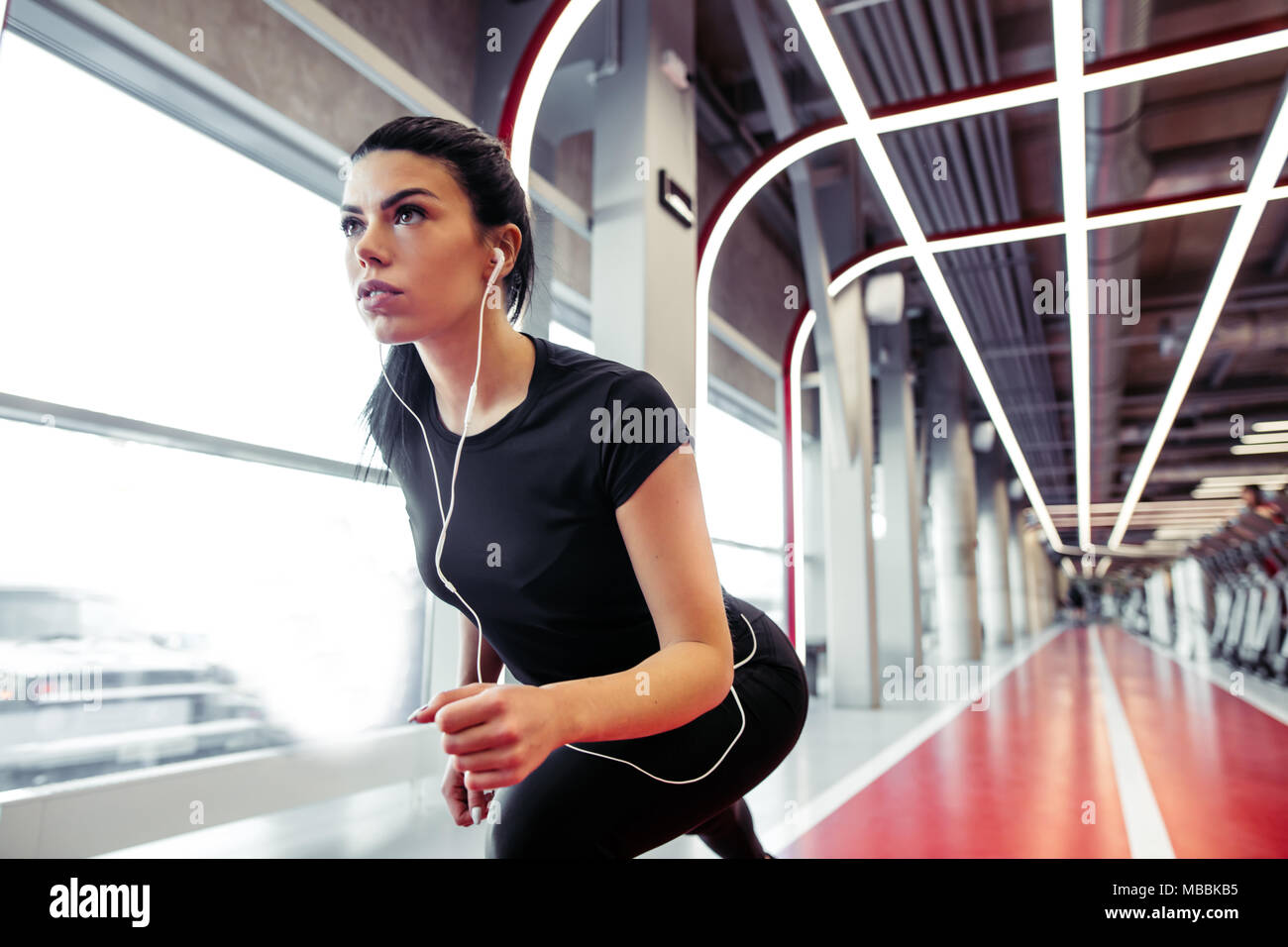 Female athlete in position ready to run. woman ready for sprint. Stock Photo