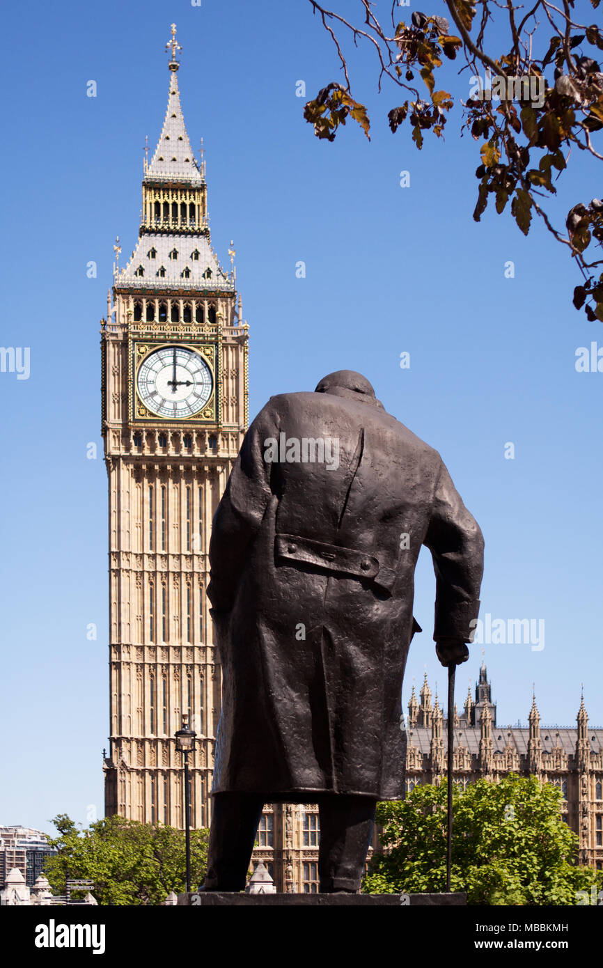 Westminster, London. The Winston Churchill statue in Parliament Square, seen from behind, with the Palace of Westminster and Big Ben in the background - Stock Image
