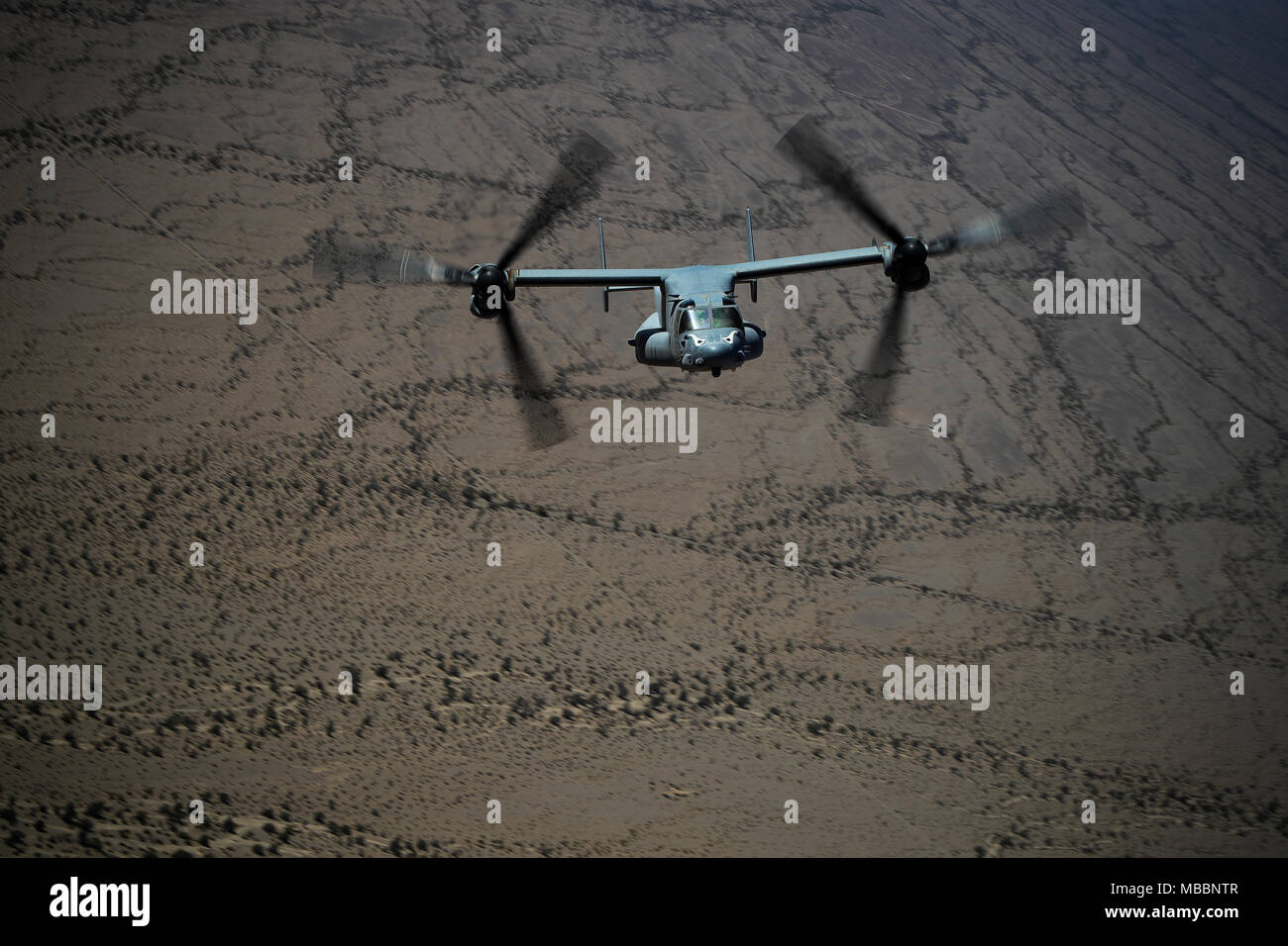A MV-22 Osprey with Marine Aviation Weapons and Tactics Squadron 1, participates in day tactic operations in support of Weapons and Tactics Instructor Course 2-18 at Marine Corps Air Station Yuma, Calif., April 7. WTI is a seven-week training event hosted by MAWTS-1 cadre, which emphasizes operational integration of the six functions of Marine Corps aviation in support of a Marine Air Ground Task Force and provides standardized advanced tactical training and certification of unit instructor qualifications to support Marine Aviation Training and Readiness and assists in developing and employing Stock Photo