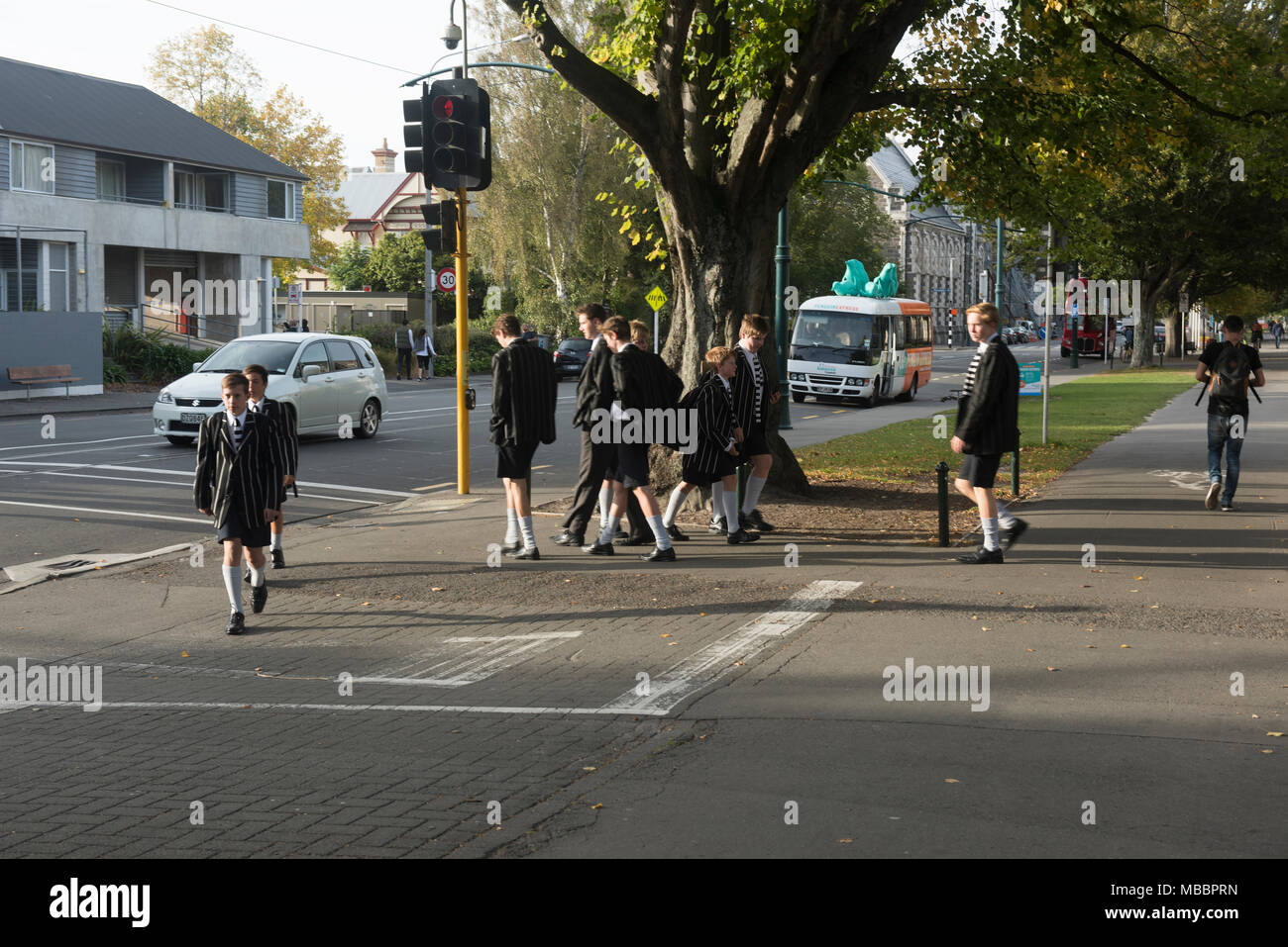 Schoolboys in uniform in front of Christ's College, ChristChurch, New Zealand - Stock Image