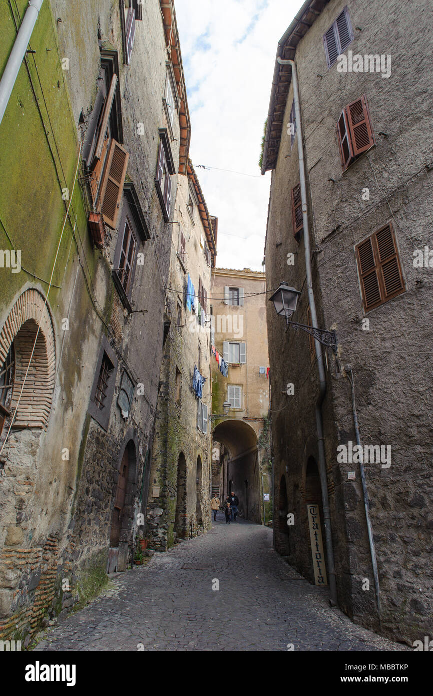ROME, ITALY - JANUARY 20, 2010: View of typical narrow street of the old town in Bracciano. Bracciano is a small old town in Lazio, Italy. Stock Photo