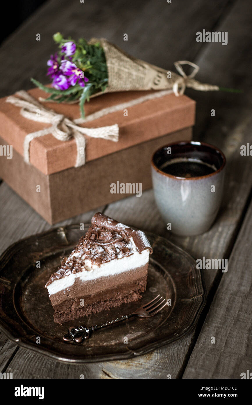 Phenomenal Chocolate Birthday Cake With Flowers Cup Of Coffee And Present Funny Birthday Cards Online Elaedamsfinfo
