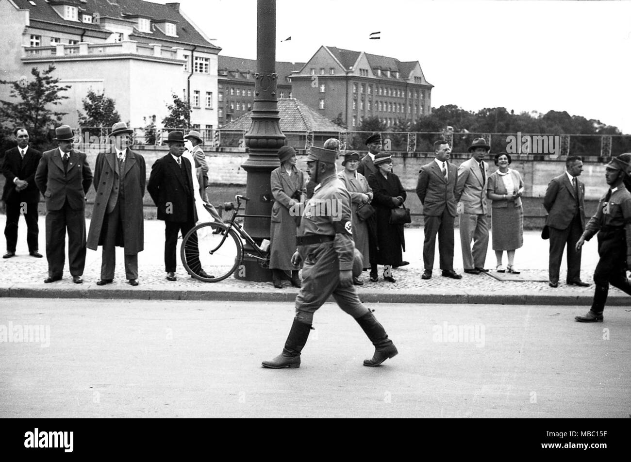 Sturmabteilung also called stormtoopers and Brownshirts carrying Swastika Flags in 1934 as they parade through Konigsberg in Germany. Konigsberg became Russian territory after the second world war and was renamed Kaliningrad. Deutschland 1930s Stock Photo