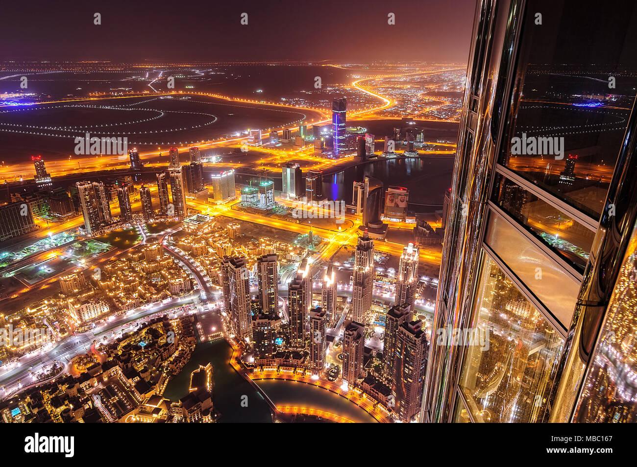 DUBAI, UAE - APR 14, 2013: Dubai downtown aerial view by night from highest skyscraper of the world Burj Khalifa, Dubai, United Arab Emirates - Stock Image