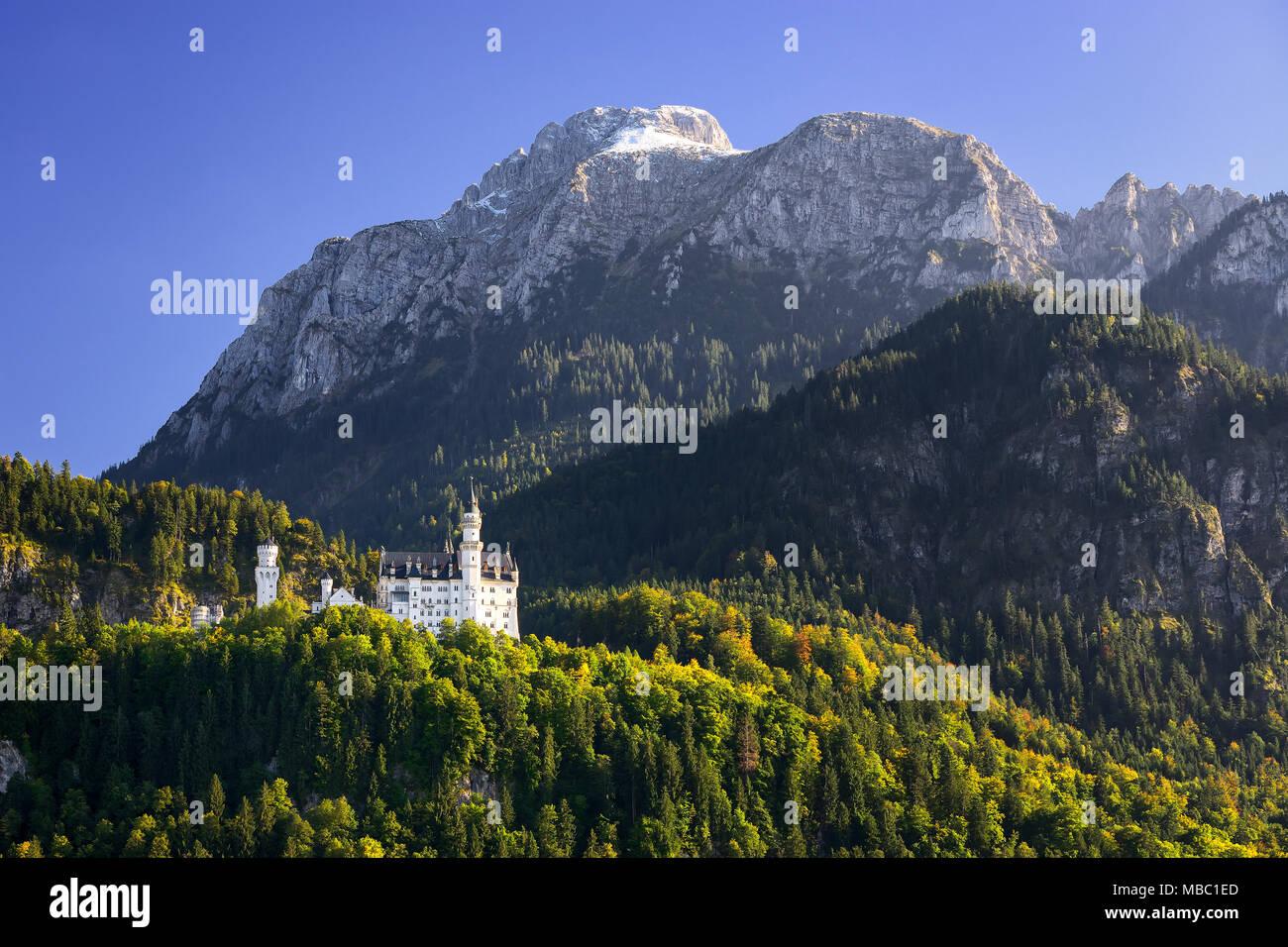 Beautiful Neuschwanstein Castle with scenic mountain landscape near Fussen, Bavaria, Germany - Stock Image