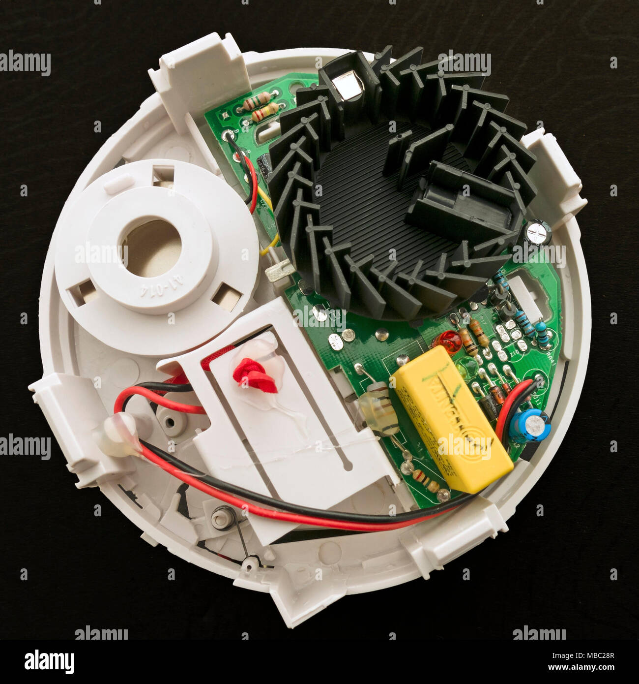 Components Inside An Optical Smoke Detector Showing The Black Photoelectric Circuit Detection Chamber Where Light Scattered By Particles Is Detected