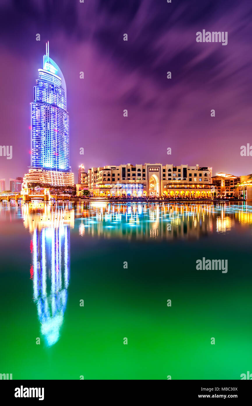 DUBAI, UAE - APR 7, 2013: Amazing night dubai downtown skyline with hotel The Address and traditional shop Souk Al Bahar, Dubai, United Arab Emirates Stock Photo