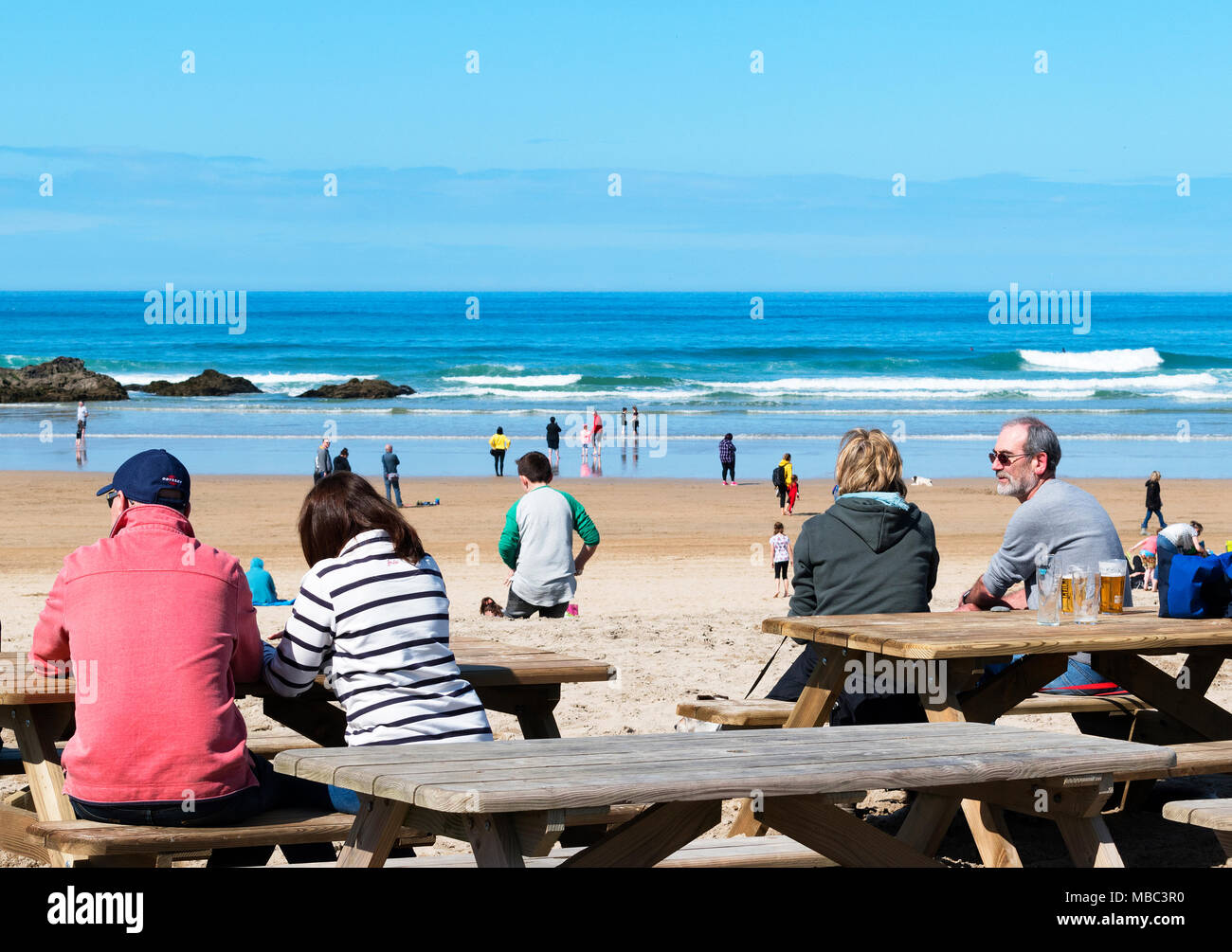 people sitting at a beach bar in perranporth, cornwall, england, britain, uk. - Stock Image