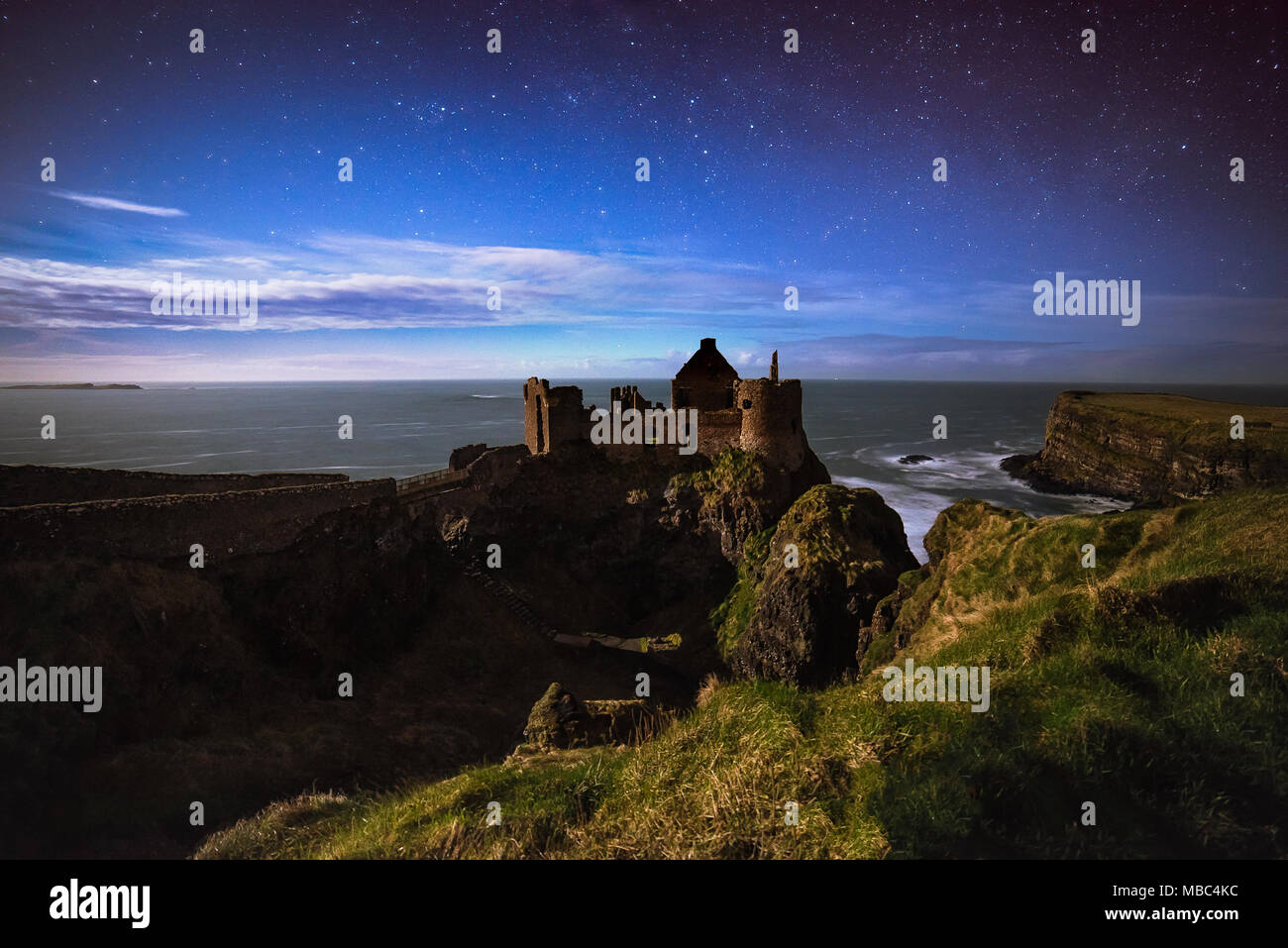Dunluce Castle at night - Stock Image