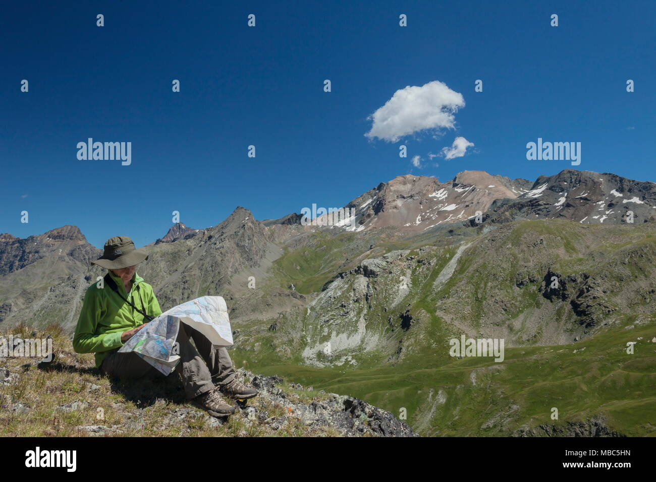 Map Of Italy With Mountains.Hiker Checking The Map Durig A Rest In The Mountains Rhemes Valley