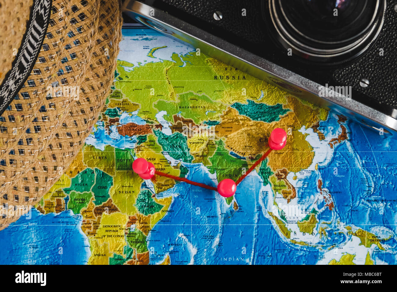 Travel destination points on world map indicated with colorful travel destination points on world map indicated with colorful thumbtacks red ribbon and shallow depth of field gumiabroncs Images