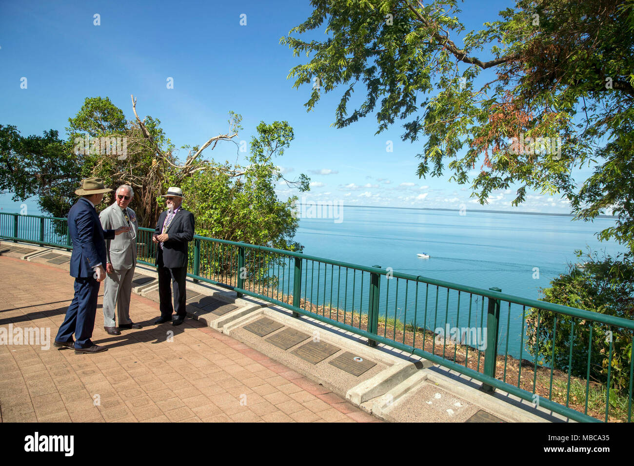 The Prince of Wales is shown memorial plaques at the Cenotaph in Darwin, Australia, by RSL President Bob Shewring, Right, and Michael Gunner, Chief Minister of the Northern Territory, Left. The memorial overlooks Darwin Harbour from which all men left during the First World War and would have been one of the last familiar sites the men would have seen as they sailed off to war and where so many died during the Japanese air attack on 19 February 1942. - Stock Image