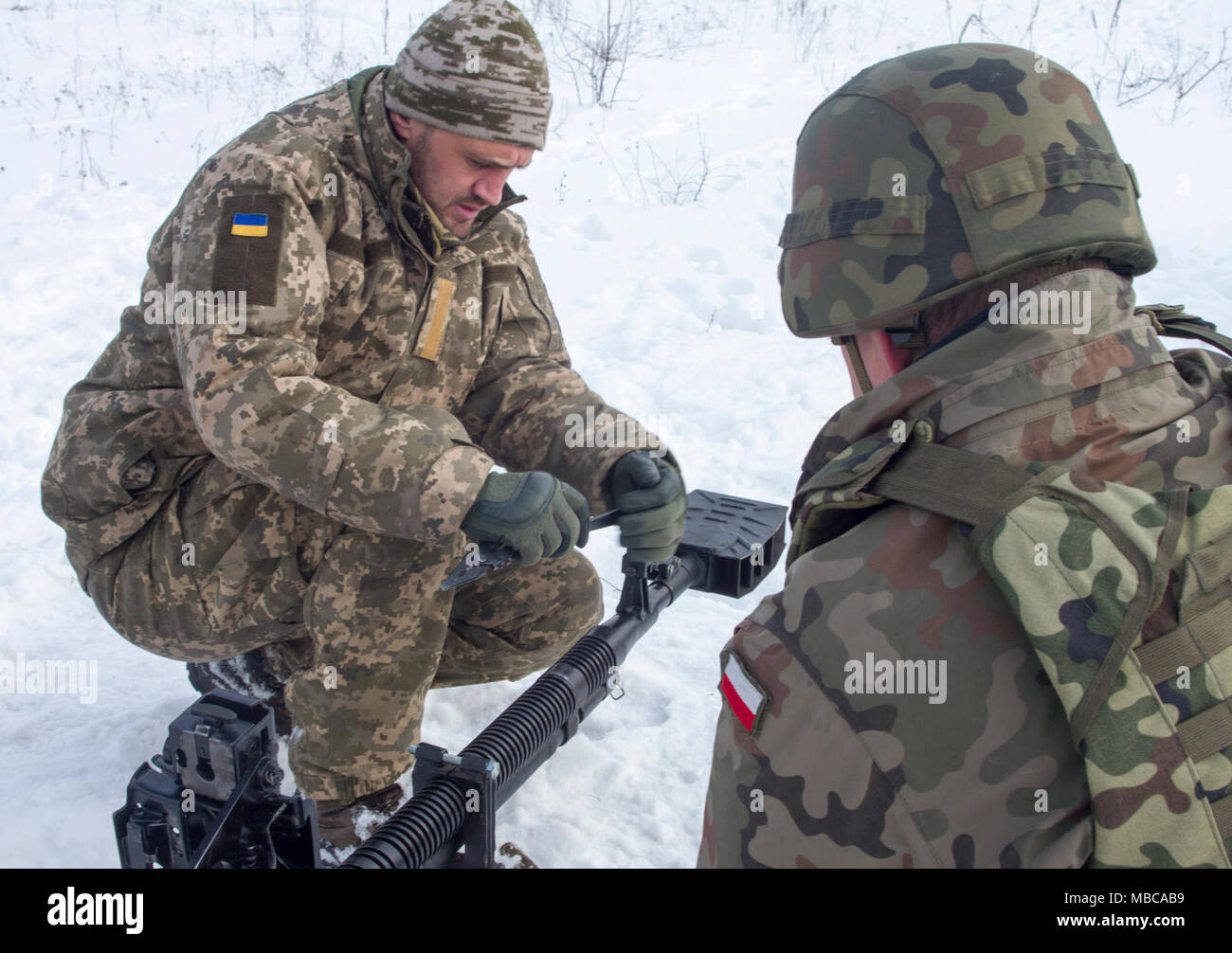 Yavoriv, Ukraine -- Ukrainian Soldiers assigned to 3rd Battalion, 14th Mechanized Brigade operate a DshK machine gun at the Yavoriv Combat Training Center (CTC) here Feb. 16. Currently the 3-14th is completing a training rotation at the CTC where they will be mentored by U.S., Canadian, Lithuanian, Polish, and U.K service members as they strive toward attaining their goal of achieving NATO interoperability. (U.S. Army Stock Photo