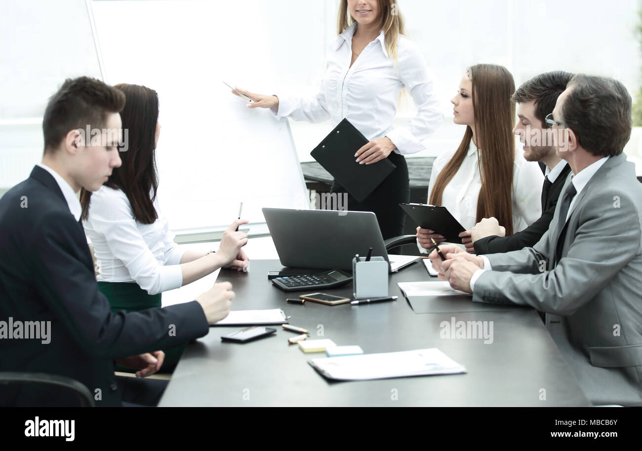 business woman conducting a presentation for business colleagues - Stock Image