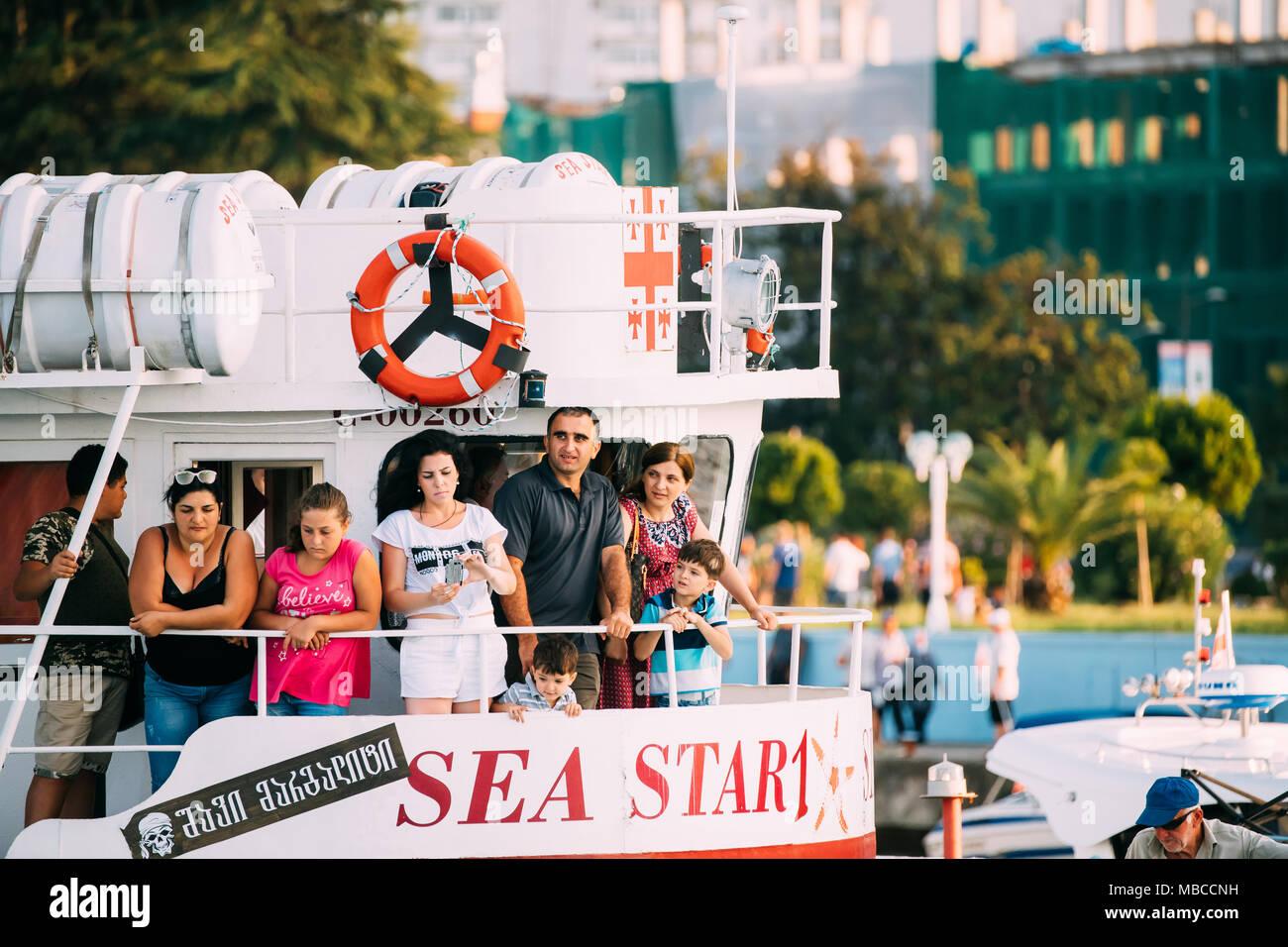 Batumi, Adjara, Georgia - September 10, 2017: People Resting In Small Pleasure Boat Tourist Boat For Cruise Near Coast In Sunny Summer Evening Stock Photo