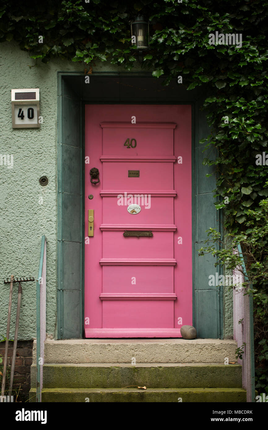 A Pink Door On A Green House With Ivy Climbing The Walls, In The Steglitz  Neighborhood Of Berlin, Germany.