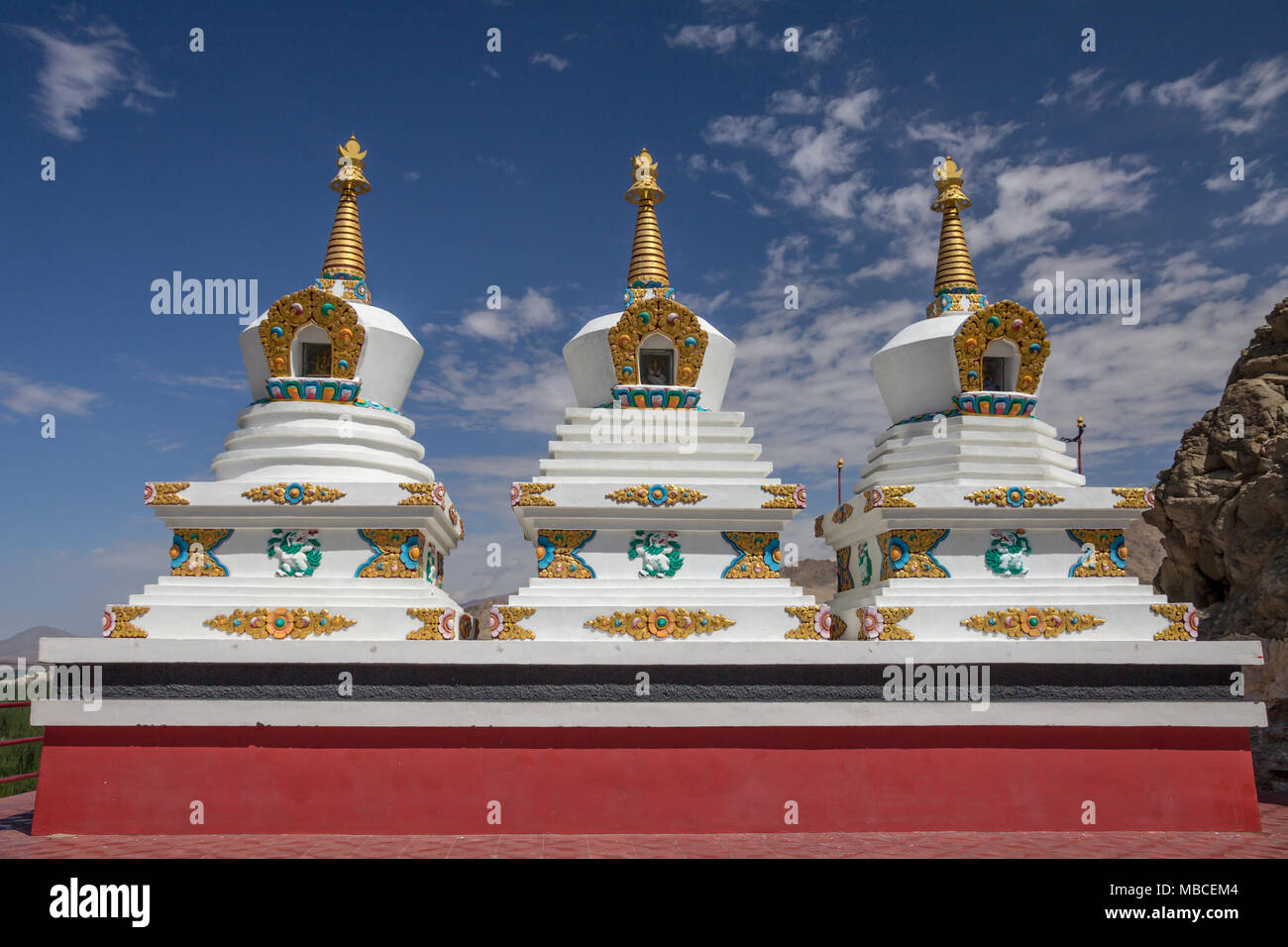 Outside Thiksay Gompa or Monastery - about 20km from Leh - are three ornate stupas.  Thiksey is affiliated with the Gelug sect of Tibetan Buddhism. Stock Photo