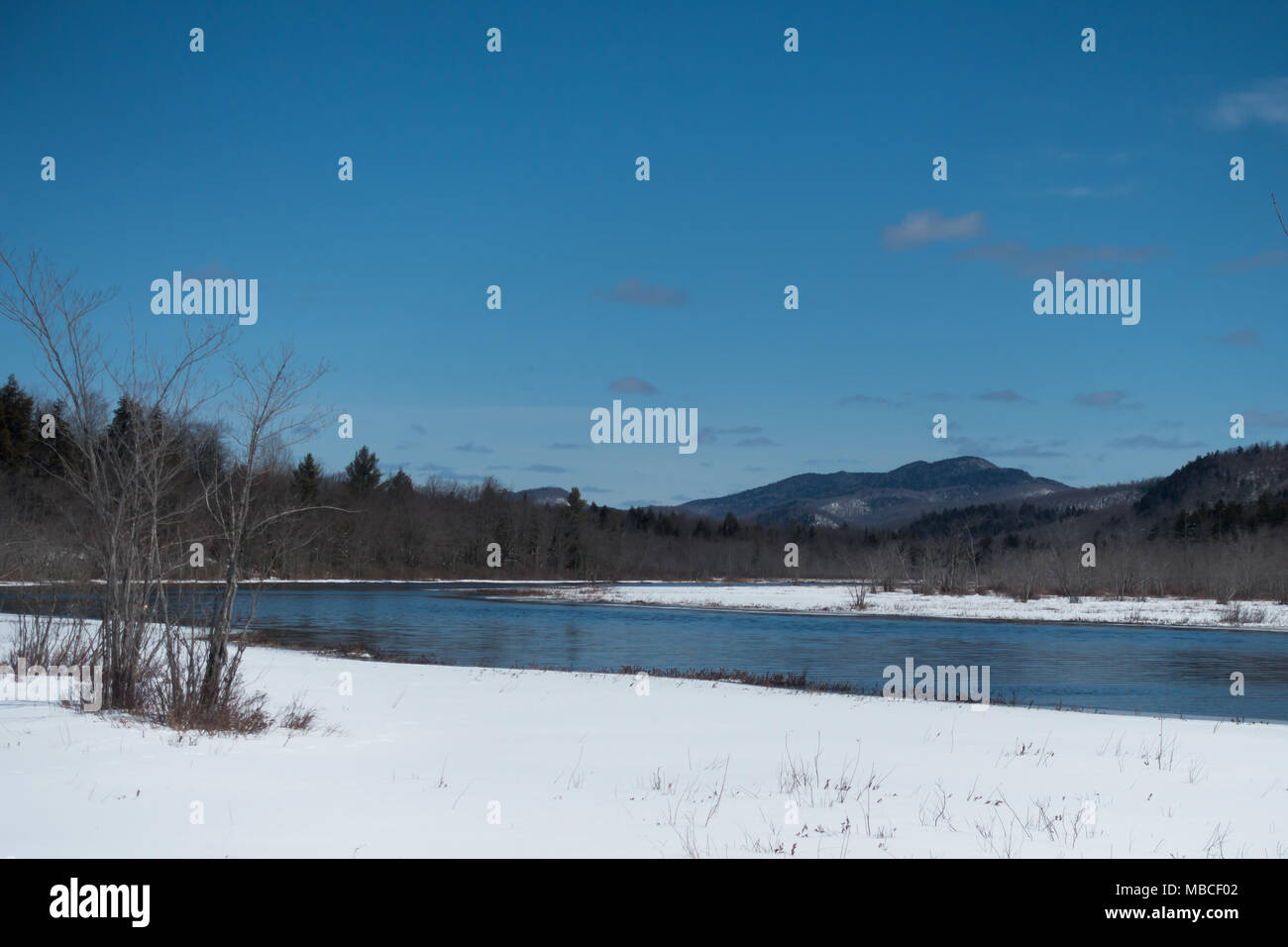 A winter view of the Sacandaga River in the Adirondack Mountains, NY USA - Stock Image