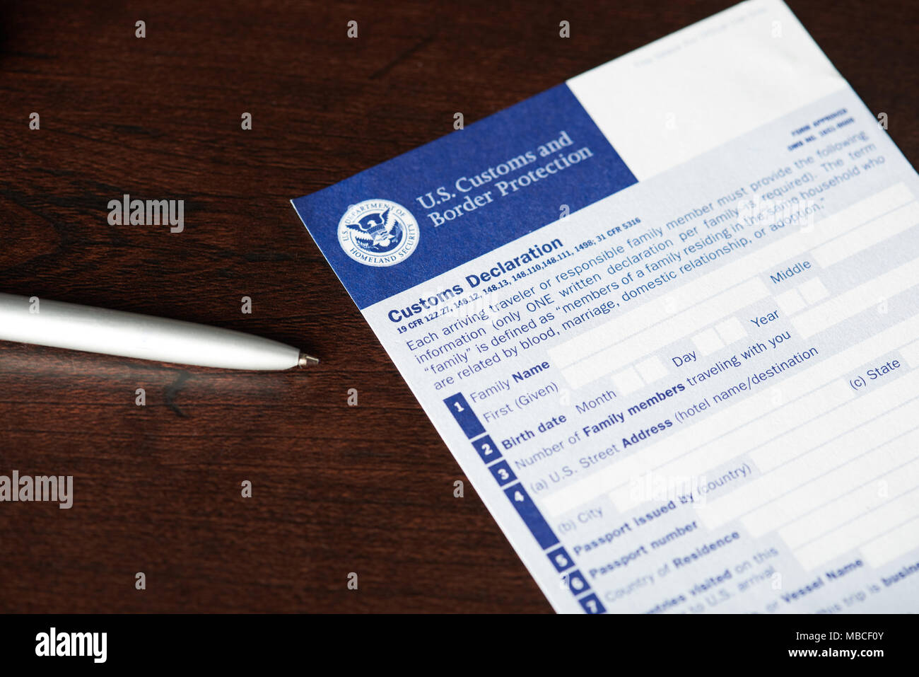 New york usa april 9 2018 empty us customs declaration form new york usa april 9 2018 empty us customs declaration form laying with pen on wooden table thecheapjerseys Image collections