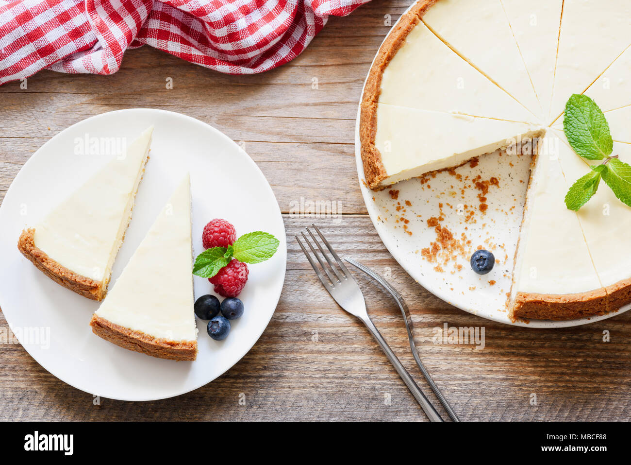 Classical New York Cheesecake on rustic wood table background, top view. Horizontal composition - Stock Image