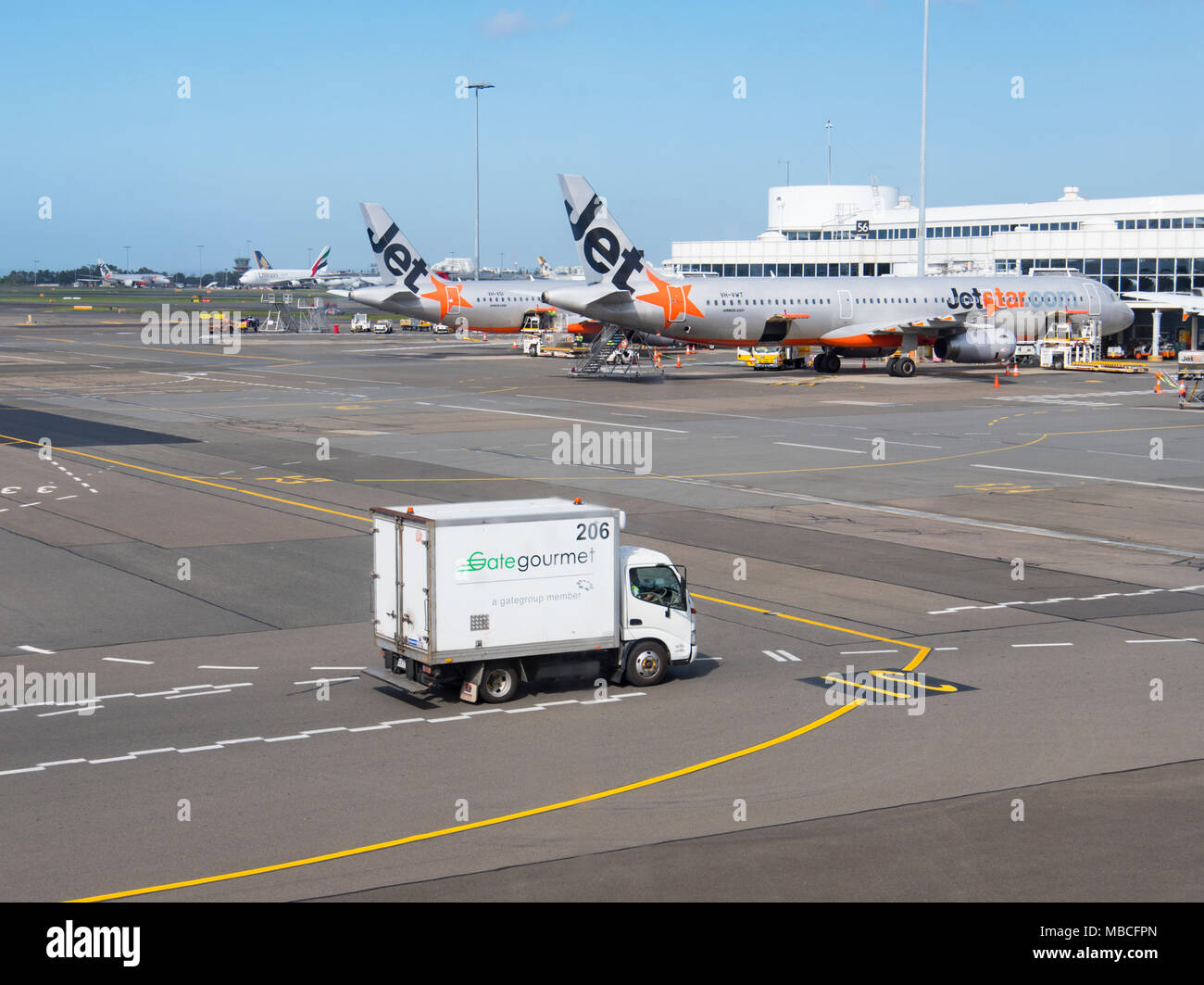 Gate Gourmet Catering Truck on the tarmac near Jetstar aircrafts at Sydney Airport, domestic terminal, Australia - Stock Image