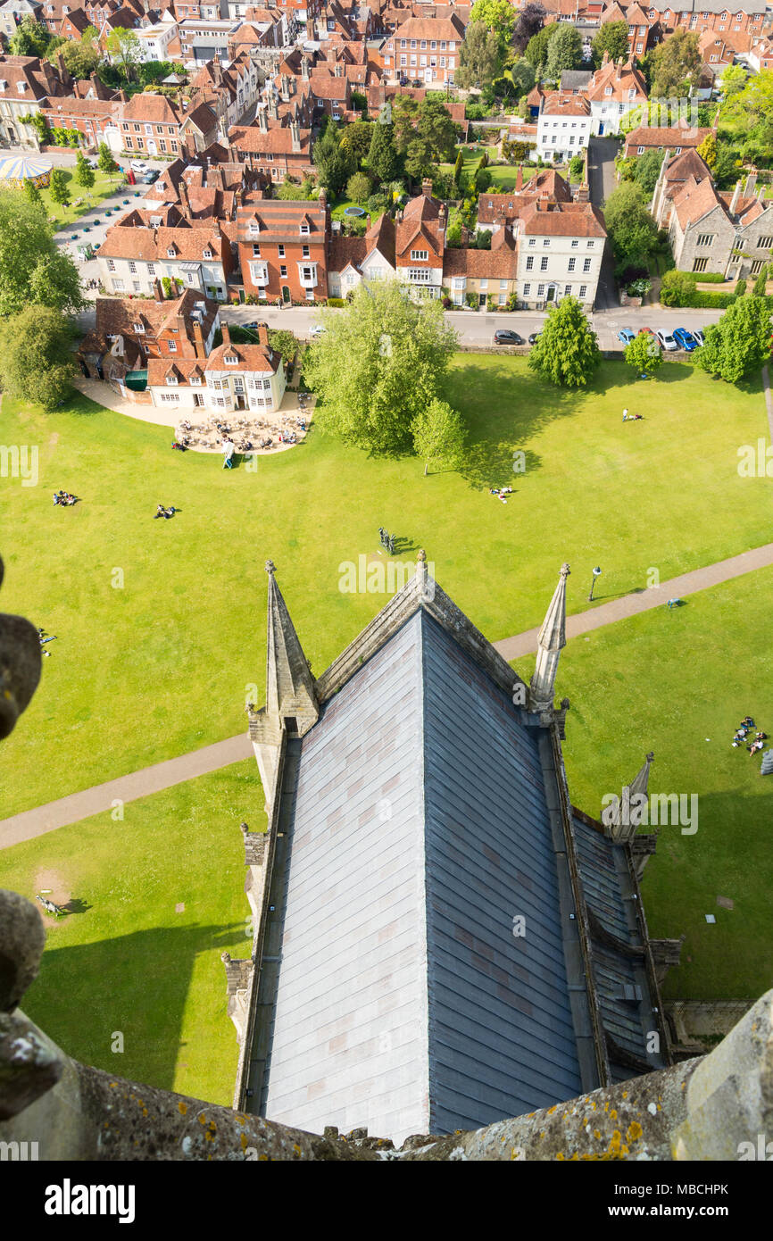 Looking down onto the leaded roof of a nave of Salisbury Cathedral and some city houses rooftops, from the tallest spire in Britain, Wiltshire, UK Stock Photo